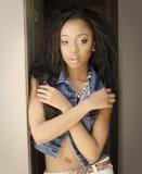 African American woman wearing denim jacket Stock Photos