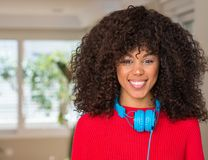 Young beautiful african american woman at home stock photography