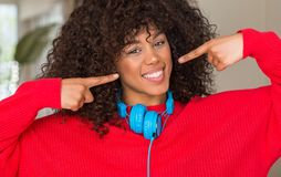 Young beautiful african american woman at home stock images