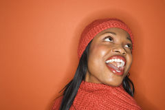 African-American woman wearing orange scarf and hat. Stock Image