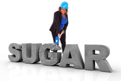 African American woman wearing a protection helmet braking a 3d. Sugar text, isolated on white background  - Black people Stock Image