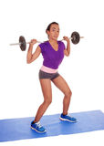 African American woman weight lifting. Royalty Free Stock Images