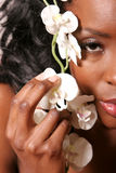 African american woman with white orchid flower Stock Photo