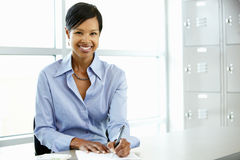 African American woman working at desk Stock Image