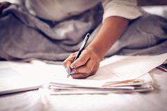Sign paper in bed. royalty free stock photo