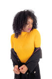 African American woman in yellow sweater. A pretty African American woman in a black coat and yellow sweater Royalty Free Stock Photography