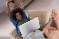 African American women at home in the chair using a laptop Stock Images
