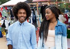 African american woman with husband at market Stock Photo