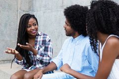 African american woman talking with friends Royalty Free Stock Images