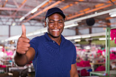 African american worker. Cheerful african american textile worker giving thumb up Royalty Free Stock Images