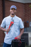 African American Worker Holding Toolbox Stock Photography