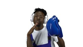African American worker listening to music on headphones. Alpha channel stock video footage