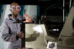 African American worker next to printing press Stock Image