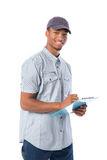 African American Worker Writing on Clipboard Royalty Free Stock Images