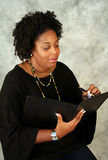 African American Writer. This woman is writing her thoughts in a journal Stock Photo