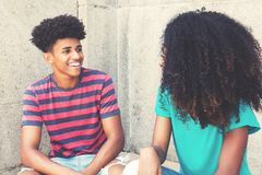 African american young adult hipster man flirting with woman stock photos
