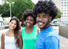 African american young adult with two beautiful girls in the city in the summer royalty free stock photo