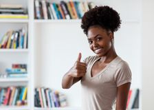 African american young adult woman showing thumb up royalty free stock photography