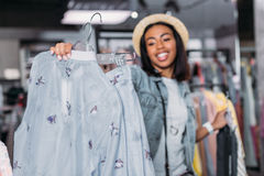African american young girl in boutique. Clothes shopping concept Royalty Free Stock Images