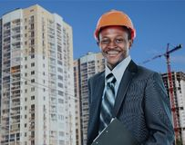 African american young Man architect on a building construction site. African american young Man architect on a building construction site Royalty Free Stock Photos