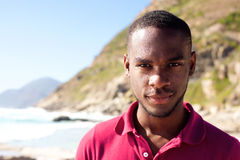 African american young man at the beach. Close up portrait of african american young man at the beach Royalty Free Stock Images