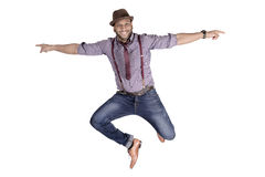 African American Young Man Fashion Model in Hat. Handsome African American young man in hat jumping funny. Copy space royalty free stock photos