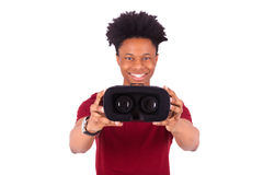 African American young man giving a vr virtual reality headset o Royalty Free Stock Image