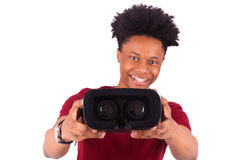 African American young man giving a vr virtual reality headset o Royalty Free Stock Photos