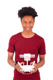 African American young man holding a drone remote control over w Stock Image