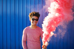 African American young man holding a smoke grenade Stock Photography