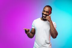 Free African-american Young Man`s Portrait On Gradient Studio Background In Neon Stock Photos - 193734683