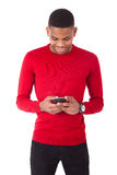 African American young man sending a text message on her smartph Royalty Free Stock Image