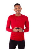 African American young man sending a text message on her smartph Royalty Free Stock Photo