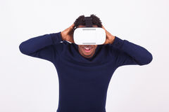 African American young man wearing vr virtual reality headset ov Stock Photos