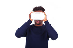 African American young man wearing vr virtual reality headset ov Stock Images