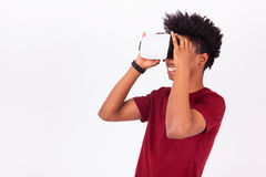 African American young man wearing vr virtual reality headset ov Royalty Free Stock Images