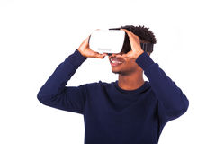 African American young man wearing vr virtual reality headset ov Stock Image