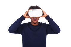 African American young man wearing vr virtual reality headset ov Stock Photography