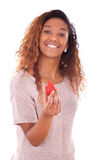 African American young woman holding a strawberry - Black people Stock Photography