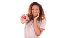 African American young woman holding a strawberry - Black people Royalty Free Stock Image