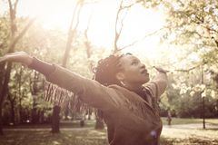 African American young woman looking in the sky. African American young woman looking in the sky and dancing Stock Photos