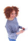 African American young woman sending a text message on her smart Stock Image