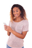 African American young woman sending a text message Stock Image