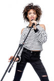 African american young woman singing with microphone isolated on white Royalty Free Stock Images