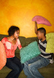 African-Americans having pillow fight Royalty Free Stock Image