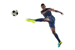 African AmericanSoccer Player Kicking Ball Stock Photo