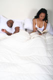 African Amrican Couple in Bed Stock Photos