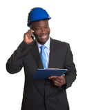 African architect laughing at phone Royalty Free Stock Images
