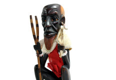 African Art. Small statue of an African farmer seated Stock Image