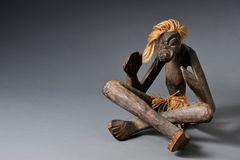 African Art. Old carved African wooden voodoo man Stock Photography